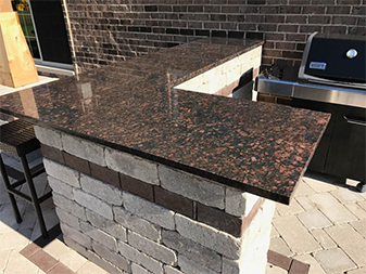 Granite Outdoor Kitchen in Manhattan by Granite Mountain. Come visit us at our showrooms in Bourbonnais or New Lenox, Illinois!