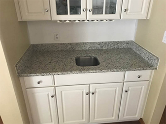 Wet bar by Granite Mountain. Come visit our showrooms in Bourbonnais or New Lenox, Illinois!